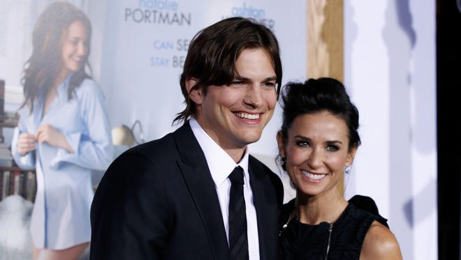 Ashton Kutcher and Demi Moore in happier times in January 2011.