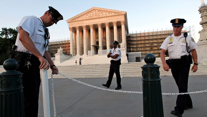 The Supreme Court wrestled Wednesday with how to keep guns out of the hands of domestic violence offenders