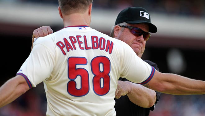 Philadelphia Phillies pitcher Jonathan Papelbon argues with Umpire Joe West after being ejected from the game against the Miami Marlins in the ninth inning of a baseball game Sunday in Philadelphia. The Marlins won 5-4. (AP Photo/H. Rumph Jr)