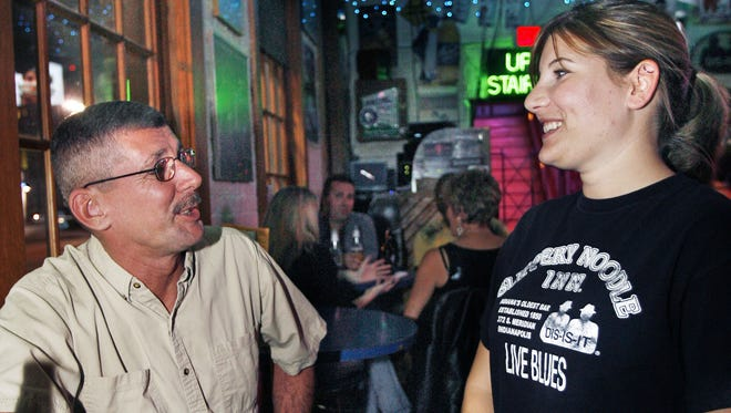 Slippery Noodle server Jamie Chew, Greenwood, chats with customer Gary Ricketts, Indianapolis.