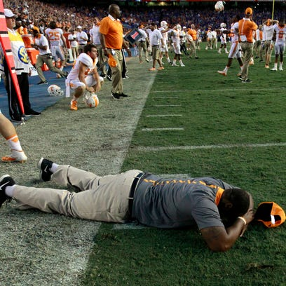 Tennessee coaches and players react as they lost to