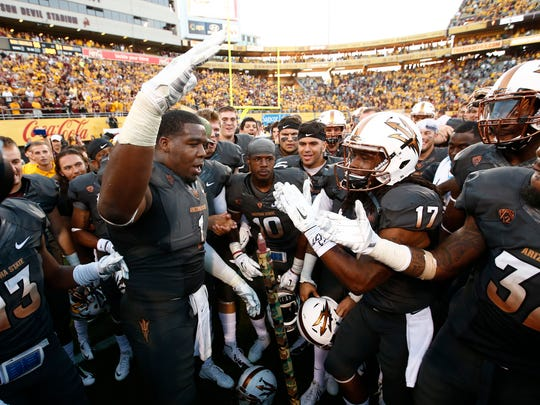 Arizona State players celebrate their win over Notre Dame on Nov. 8, 2014 at Sun Devil Stadium in Tempe.