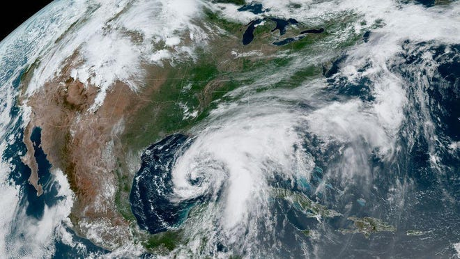 A satellite image shows Tropical Storm Cristobal churning north in the Gulf of Mexico Saturday morning.