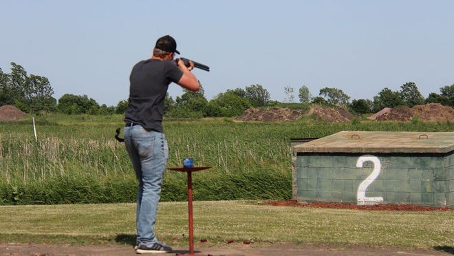 Kadon Strong lines up one of his shots in his second round on Sunday, June 14 at the Sleepy Eye trap shooting range.