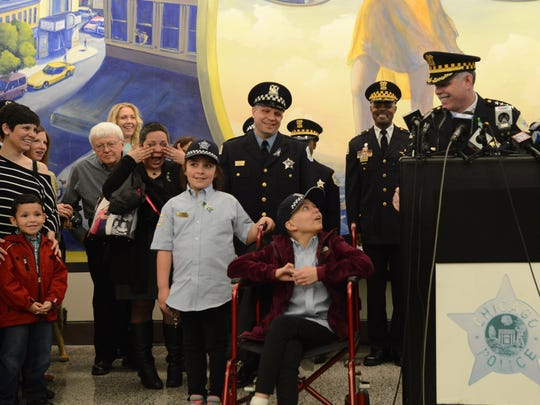 Cancer patient Emily Beazley jokes with Superintendent Garry McCarthy before she and her sister, Olivia, are made honorary police officers in April in Chicago. When Emily died, the news was shared on Facebook — as were most updates on her illness over the last four years. Such openness is a relatively recent phenomenon and can be therapeutic, experts say.