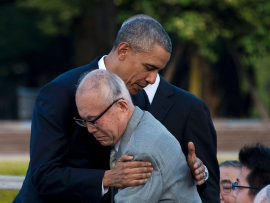 President Barack Obama hugs Shigeaki Mori, a survivor of the 1945 atomic bombing of Hiroshima, during a visit to the Hiroshima Peace Memorial Park on May 27, 2016.