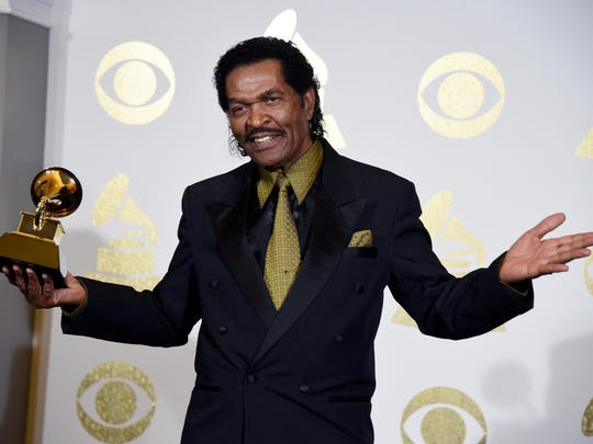 "Bobby Rush poses in the press room with his Grammy for Best Traditional Blues Album for ""Porcupine Meat"" at the 59th annual Grammy Awards at the Staples Center Sunday in Los Angeles."