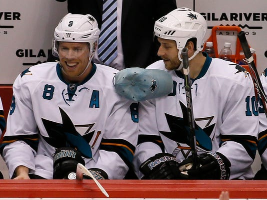 San Jose Sharks' Joe Pavelski (8) has a hat thrown his way after scoring his third goal against the Arizona Coyotes during the third period of an NHL hockey game, Friday, Feb. 13, 2015, in Glendale, Ariz. At right is Andrew Desjardins (10). The Sharks won 4-2. (AP Photo/Matt York)