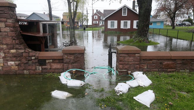 High water fills a yard on Edgemere Dr. in Greece.