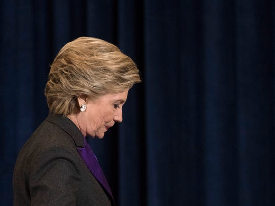 Hillary Clinton walks off the stage after speaking