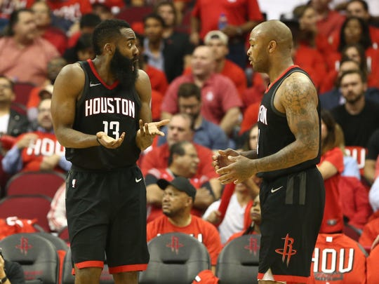 Houston Rockets guard James Harden (13) reacts with