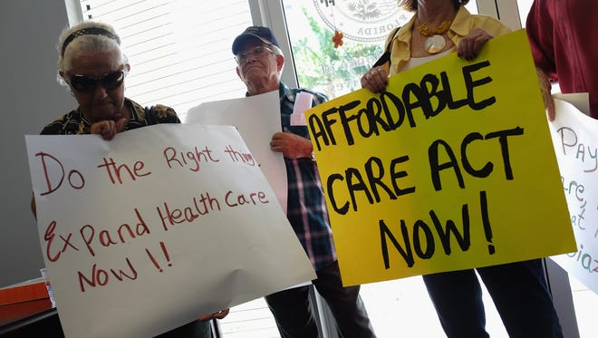 Demonstrators for the Affordable Care Act in Miami on Friday.