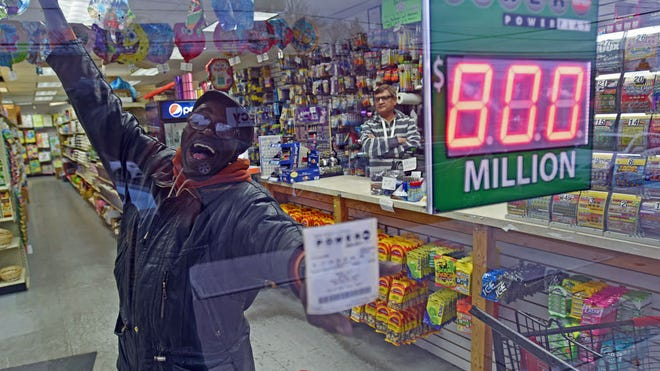 An enthusiastic and optimistic LeRoy Jackson of East Orange shows off his Powerball lottery ticket through the window of the Jersey Dollar Store where he purchased it in North Arlington.