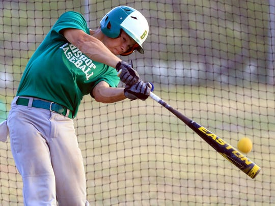Bishop's Treston Pool swings at the ball during practice Wednesday, May 3, 2017, at Bishop High School in Bishop.