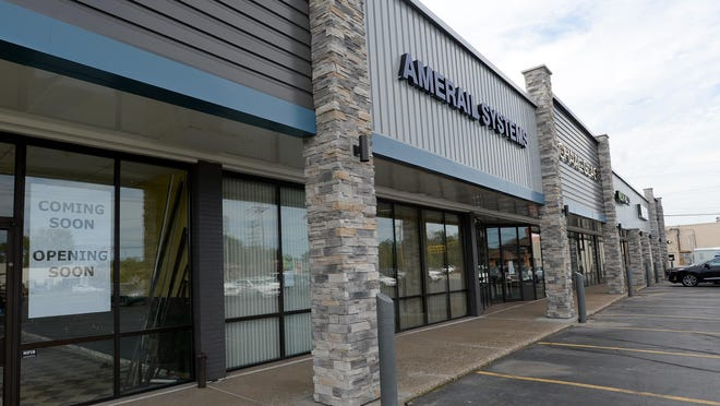 A new brick facade was recently completed at the Schaal Plaza on West. 12th St. in Millcreek Township. The plaza houses five retail businesses and the headquarters of two national corporations.