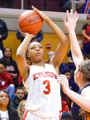 Detroit Edison's Gabrielle Elliott takes a shot with