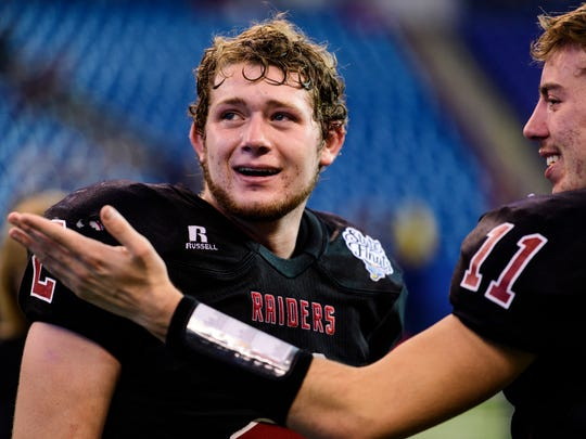 Southridge's Jayce Harter (2) and Grant Maxey (11) are overcome with emotion as they discuss their IHSAA Class 2A State Championship win over the Woodlan Warriors at Lucas Oil Stadium in Indianapolis, Ind., Saturday, Nov. 25, 2017. The Raiders defeated the Warriors, 15-14, to win their first state title in school history.