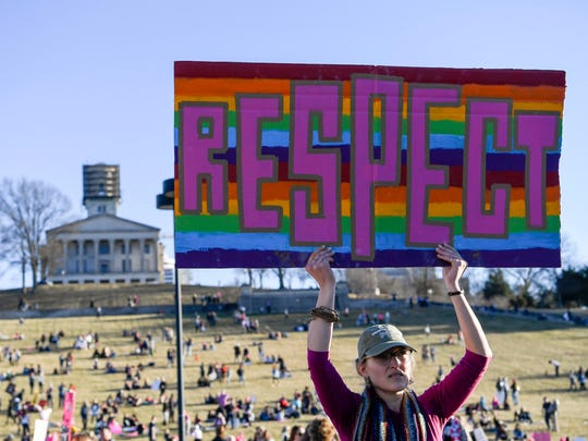 Abby Moorman holds up a sign at the Women's March in Nashville, Tenn., Saturday, Jan. 20, 2018.