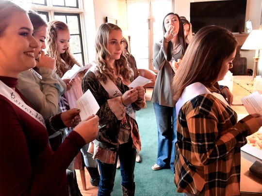 Abilene High School's Ashley Fisher,16, center, listens to instructions along with other Miss Snake Charmer contestants Friday at the Sweetwater Chamber of Commerce. Media Day for the World's Largest Rattlesnake Roundup is designed to introduce the girls to the Big Country and to learn one of the biggest duties of Miss Snake Charmer - skinning a rattlesnake.