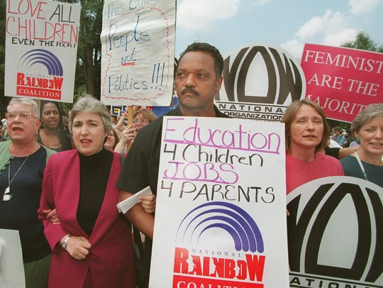 The Rev. Jesse Jackson and women's rights leaders call