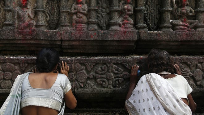 Indian women perform rituals during the  Ambubachi festival at Kamakhya temple in Guwahati on June 24. Thousands of devotees gather to celebrate Ambubachi Mela to mark the menstruation period of the goddess Devi Kamakhya.