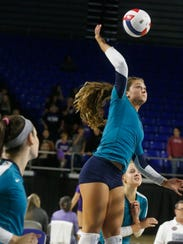 Siegel's Julia Wheeler (5) hits the ball over the net