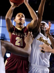 RiverdaleÕs Rashaad Thompson (21) goes up for a shot