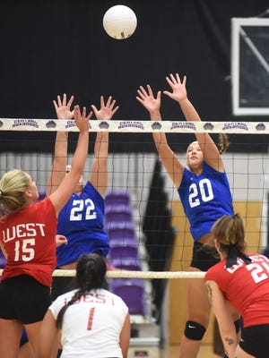 Mountain Home's Maly Tabor (20) attempts a block for the East during the AHSCA All-Star volleyball match Friday night in Conway.