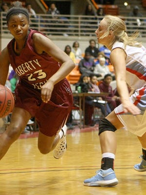 Gibson County's Erin Lannom (right) is in her senior year for the Lady Pioneers.
