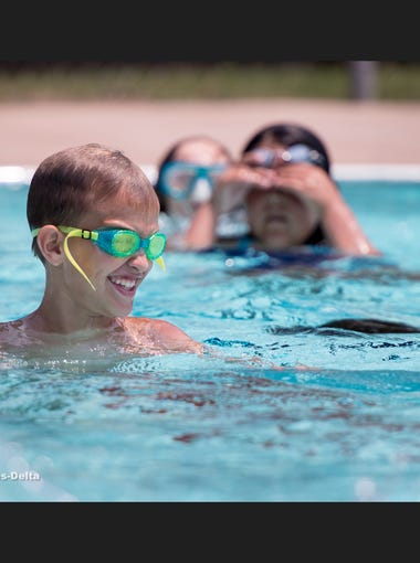 Ethan Chapman plays Marco Polo during Adventure Camp at Golden West High School on Thursday, July 26, 2018.