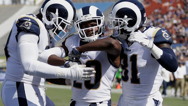 Free safety Lamarcus Joyner, center, was given the franchise tag by the Rams on Tuesday.