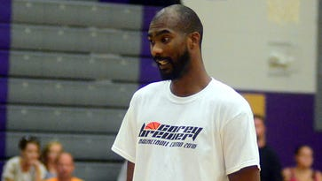 """Corey Brewer assists campers in a game of """"Simon Says"""" during his basketball camp at Portland High School on Saturday."""