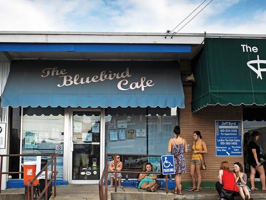 Patrons wait in line outside The Bluebird Cafe in Green