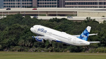A JetBlue Airways Airbus A320-232 takes off May 15, 2014, from the Tampa International Airport in Tampa, Fla.