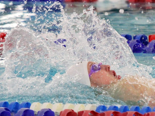 Kenyon Winkky of Horseheads swims to a 100-yard backstroke