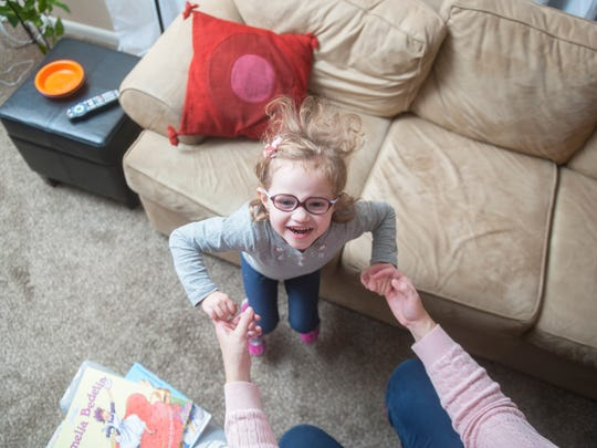 Five-year-old Emilia Schalick dances with her mother Meredith in their Cherry Hill home. Emilia has a rare genetic disorder called alternating hemiplegia of childhood and sometimes has episodes of partial or full-body paralysis. Meredith Schalick teaches at Rutgers School of Law and has organized a fundraiser for a nonprofit that raises research funding.