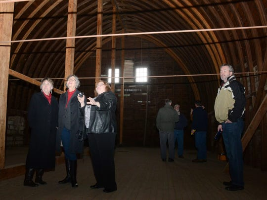 Herbie Flynn (left), Joy Juderman, Mary Sonnier and Roger Corley look around the upstairs portion of the old Dairy Barn located on the grounds of Central Hospital in Pineville.
