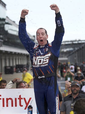 EXFINITY Series driver Kyle Busch (18) celebrates winning the Lilly Diabetes 250 Saturday, July 23, 2016, afternoon at the Indianapolis Motor Speedway.