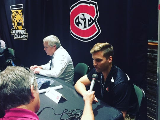 St. Cloud State senior Judd Peterson (right) is interviewed
