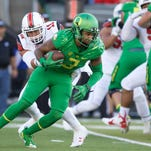 Sep 26, 2015; Eugene, OR, USA; Oregon Ducks quarterback Vernon Adams Jr. (3) runs the ball past Utah Utes defensive end Kylie Fitts (11) at Autzen Stadium. Mandatory Credit: Scott Olmos-USA TODAY Sports