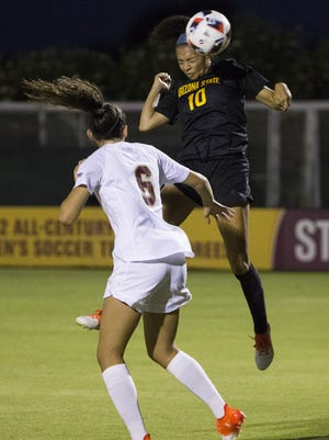 ASU forward Jazmarie Mader (10) heads the ball away from Denver University Cheyenne Shorts (6) in the first half at Sun Devil Soccer Stadium in Tempe September 4, 2016. ASU lost 3-1.