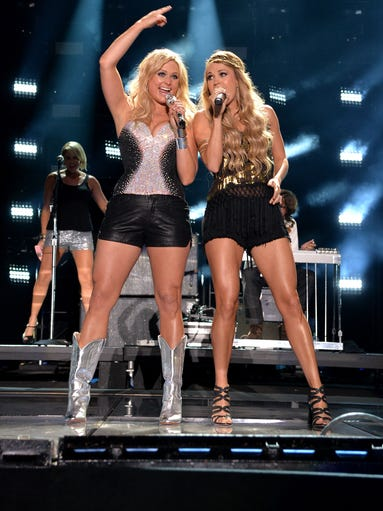 Miranda Lambert and Carrie Underwood perform during the 2014 CMA Festival on June 6, 2014 in Nashville, Tennessee.