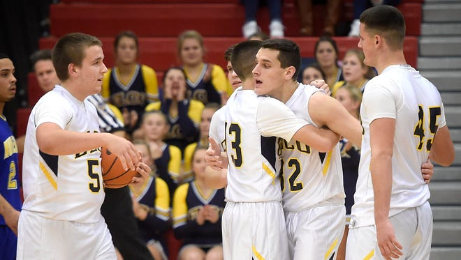 The Elco Raiders defeated the Muhlenberg Mules 78-33 on the opening night of the 17th Annual Lebanon Athletic Booster Tip-Off Tournament Friday, Dec. 4. After scoring his 1,000 career point Colton Lawrence was congratulated by his coach and teammates.