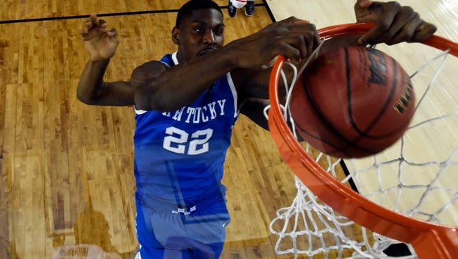 UK forward Alex Poythress dunks the ball during the first half against Connecticut during the championship game.