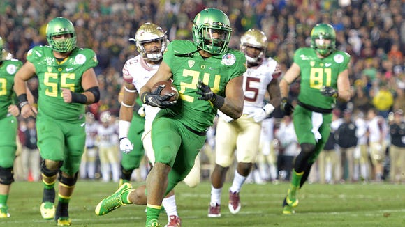Jan 1, 2015; Pasadena, CA, USA; Oregon Ducks running back Thomas Tyner (24) scores on a 21-yard touchdown run in the fourth quarter against the Florida State Seminoles in the 2015 Rose Bowl college football game at Rose Bowl. Oregon defeated Florida State 59-20. Mandatory Credit: Kirby Lee-USA TODAY Sports