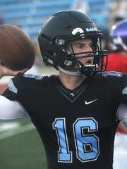 Six-foot-6 freshman Ethan Postler is in a battle to be the starting quarterback for Moorpark College.