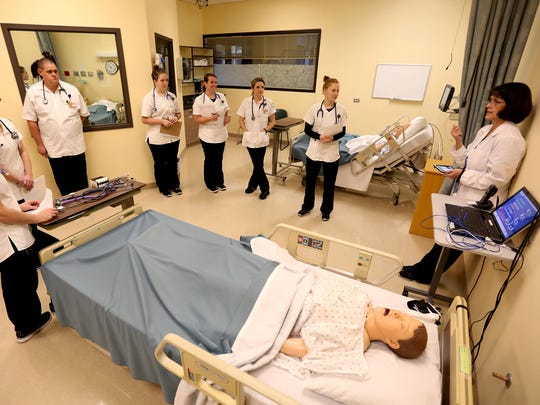 Nursing skills instructor Leanne Whygle, far right, leads a skills lab and simulation class for first-year nursing students at Chemeketa Community College in Salem on Monday, Nov. 23, 2015.
