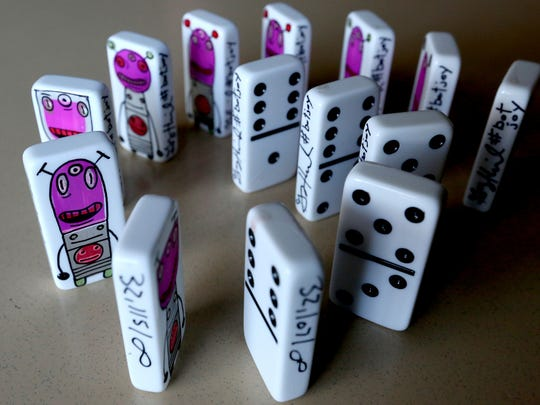 Brave Bots, designed by a Portland artist, have been donated to children who attend grief counseling and support groups at Willamette Valley Hospice in Salem on Wednesday, Nov. 25, 2015. Each hand-painted domino is meant to inspire courage in those who hold them.