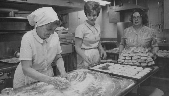 Patricia Harding, Mrs. William Fellows (center) and Mrs. Richard Willey (right) prepare 3,000 shortcakes for the 1972 Strawberry Festival.  John Starkey/The Star