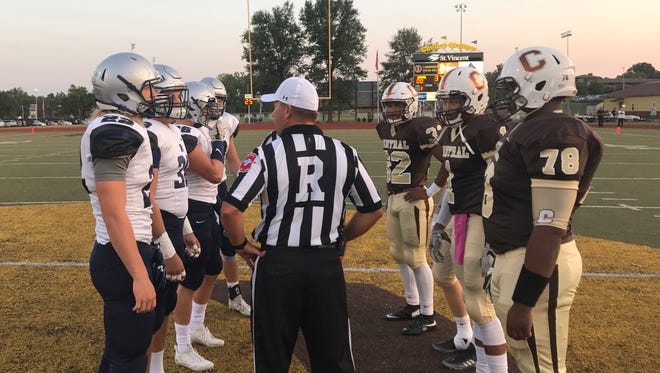 Reitz and Central wait for the coin toss before Friday's showdown